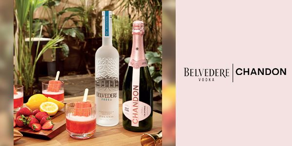 Photo of Belvedere Vodka and a bottle of Chandon Sparkling Rose together next to cut fruit and cocktails.